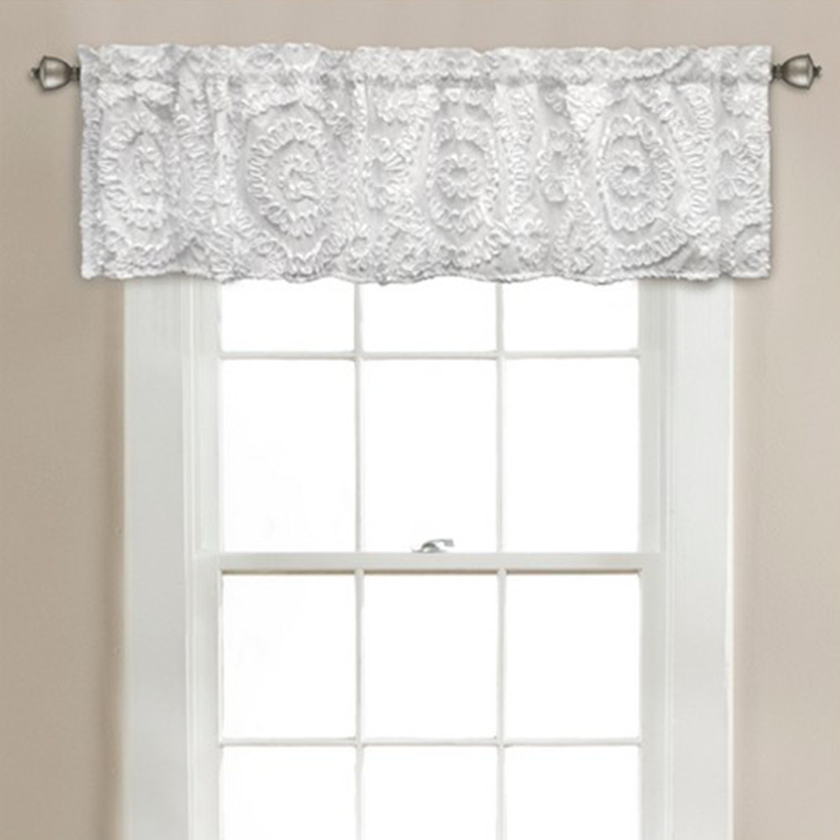 White window valence with textured, lace-like details photo