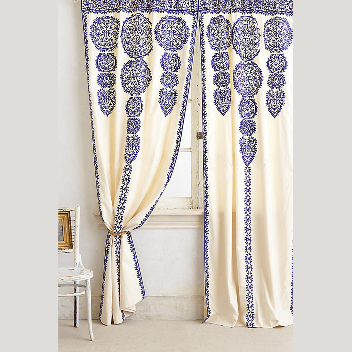 Anthropologie drapes with blue embroidery and smooth cotton lining. photo