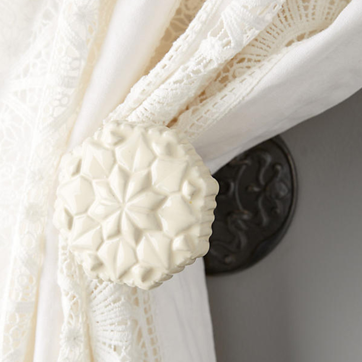 Carved curtain tieback in ivory photo