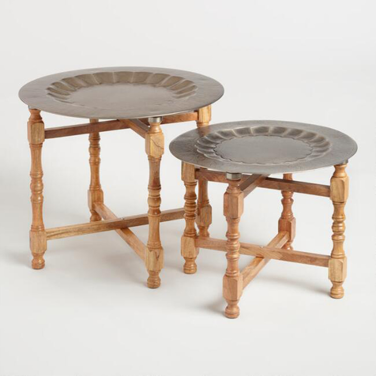 Inspired by traditional Indian tea serving trays, this set made of mango wood and embossed iron creates a unique ambience. photo
