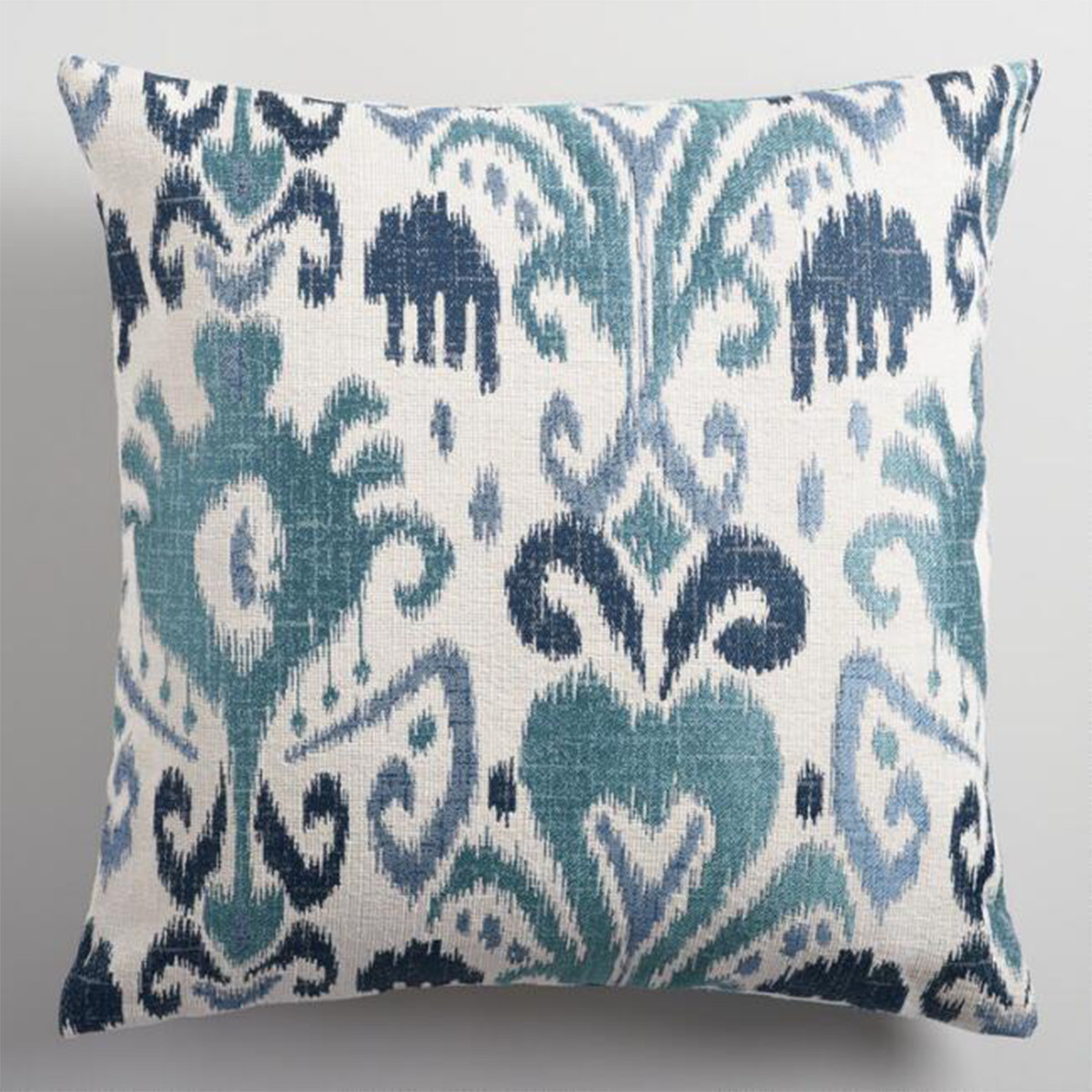 Featuring a trendy ikat design in soothing shades of blue, this throw pillow will be a standout addition to your home. photo