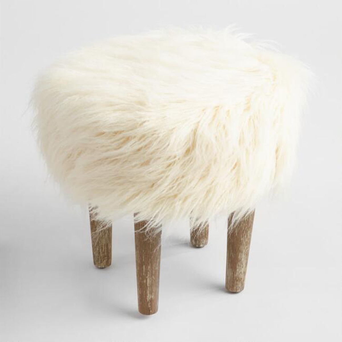 Pair this textured stool with more neutral pieces for balance in your living room, bedroom, or home office. photo
