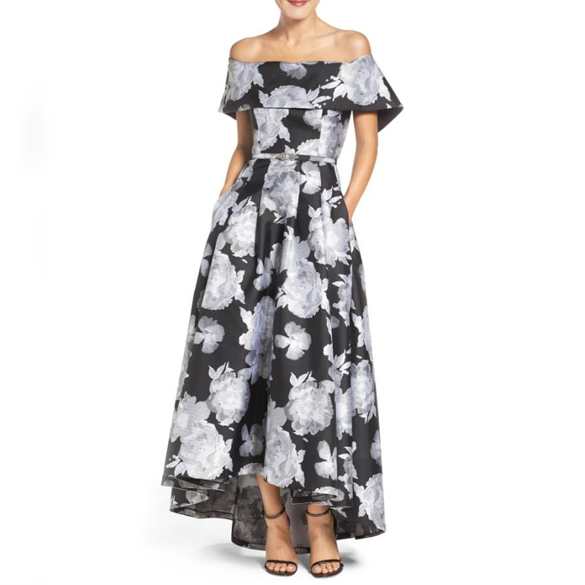 Woman wearing a floral off-the-shoulder dress photo