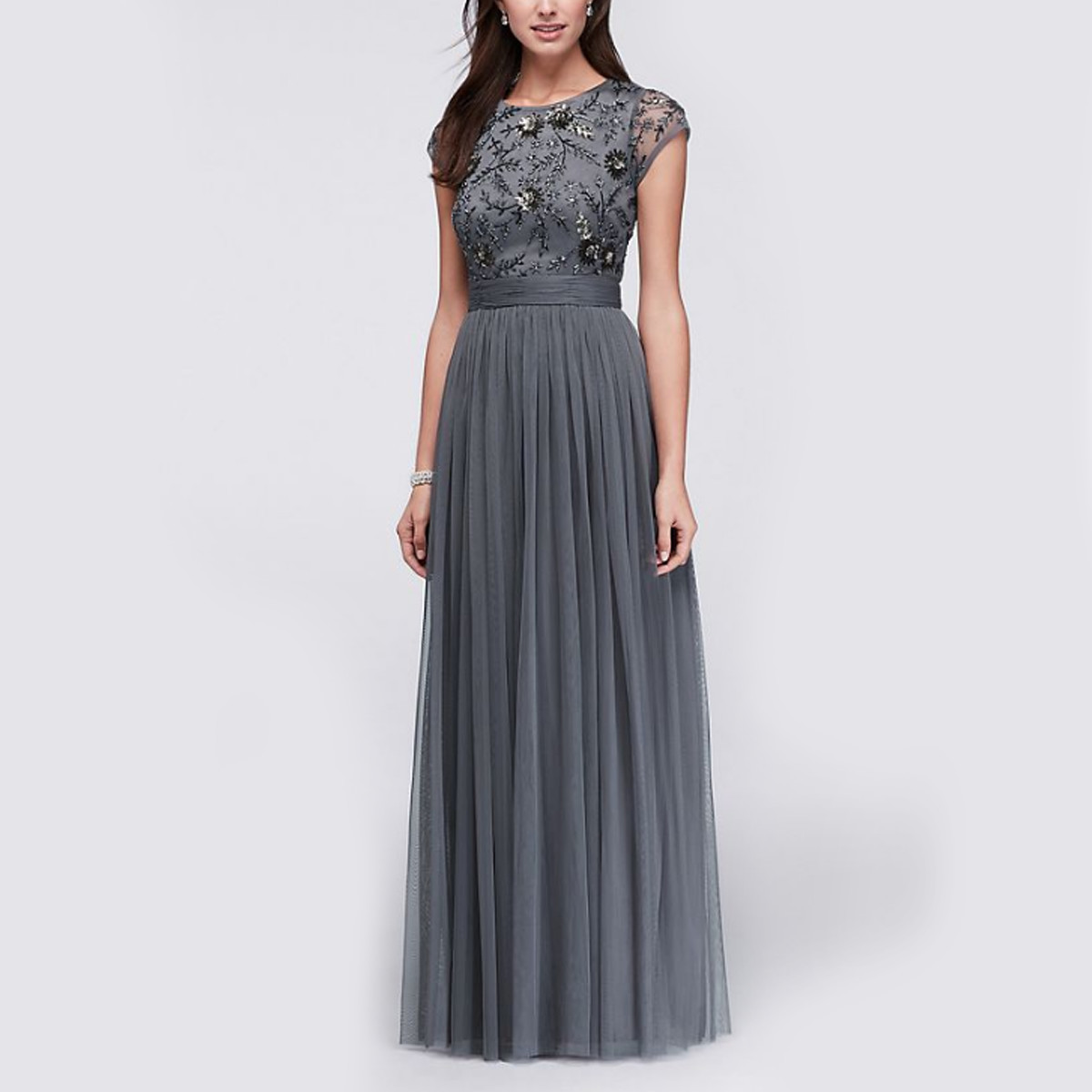 Woman wearing a gray mother of the bride dress photo