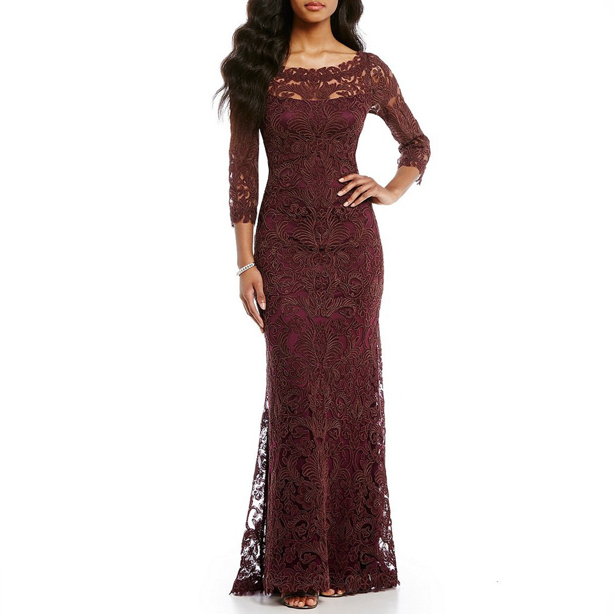 Woman wearing a maroon lace mother of the bride dress photo
