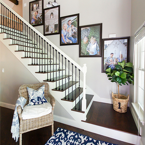 Eye-catching gallery wall over staircase using bronze monteclair poster frames. photo