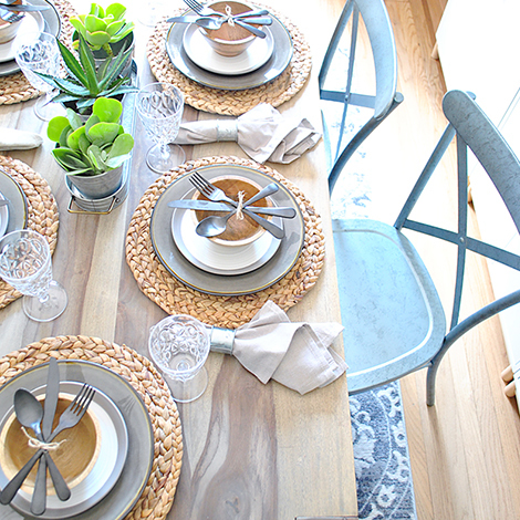 Give your dining room a stylish update by adding Collin Silver dining chairs, distressed area rug, gray dinnerware set, and Ashmoore salad plate for a complete table. photo