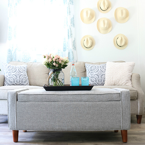 Add the Flynn storage ottoman and stylish rope lantern to dress up your living space. photo