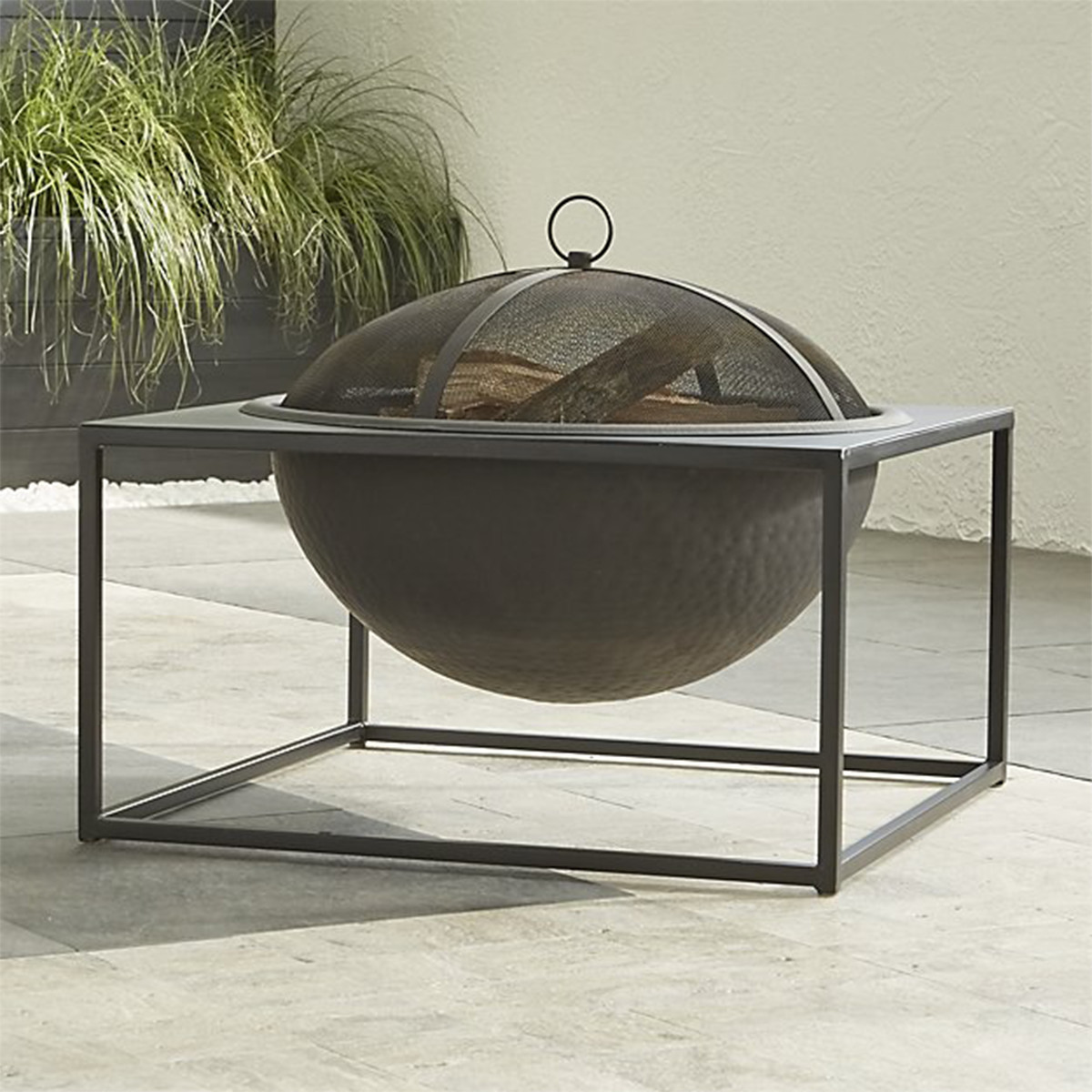 Crate and Barrel lare fire pit with cover photo