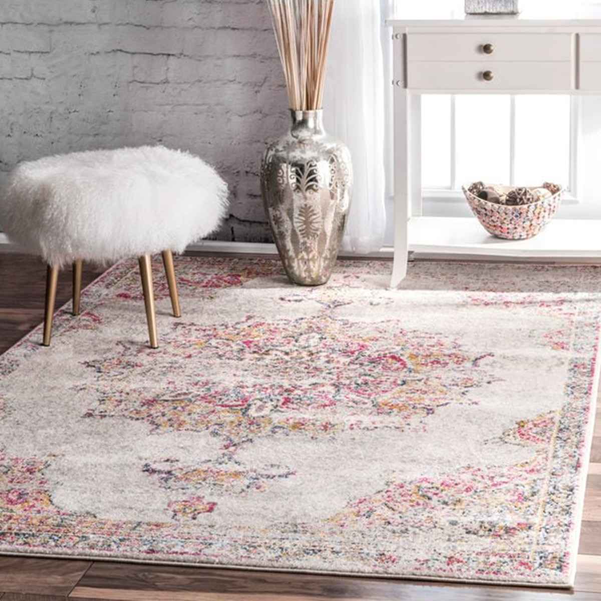 Persian-inspired rug that features a faded design. photo