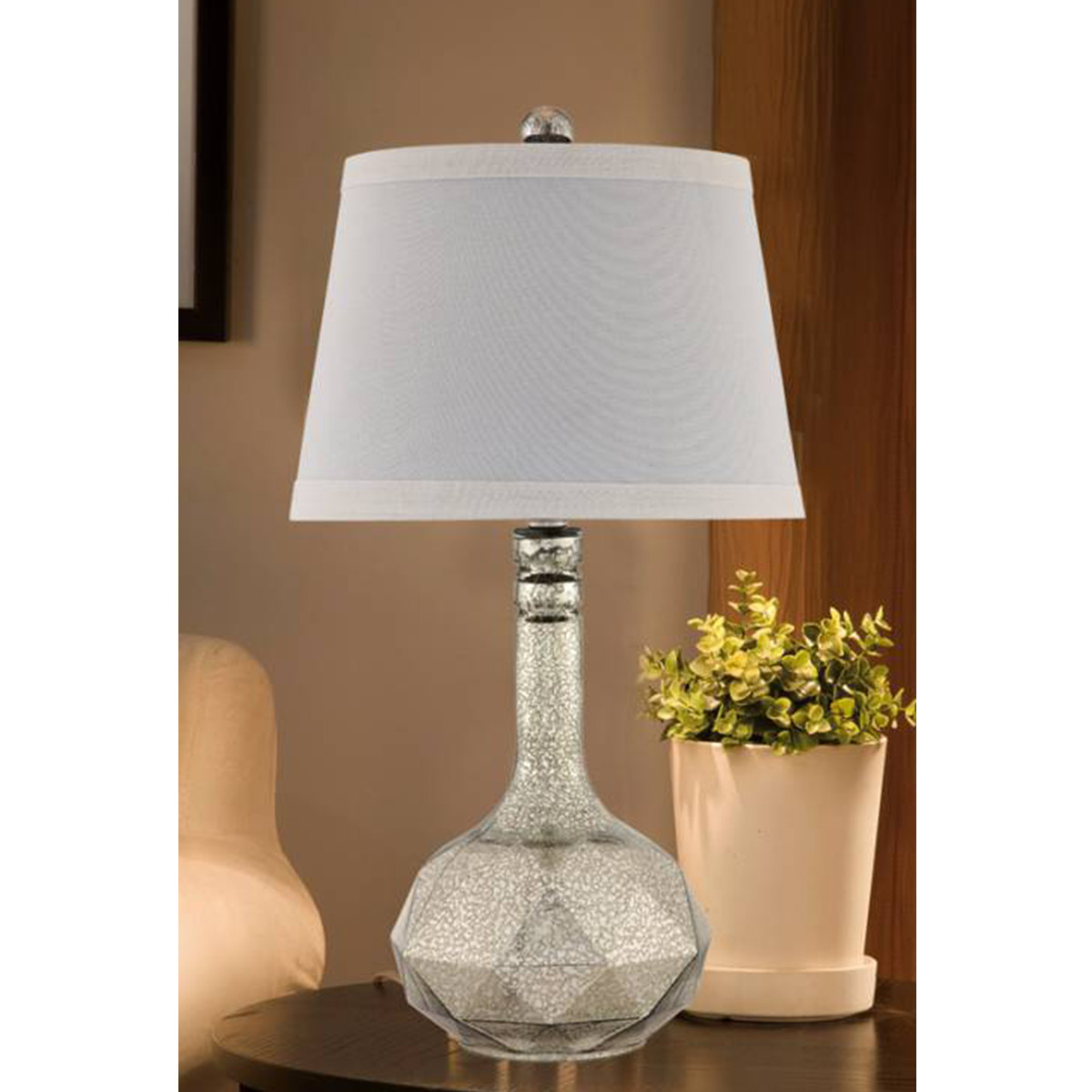 Table lamp with a crackled metallic base and white shade photo