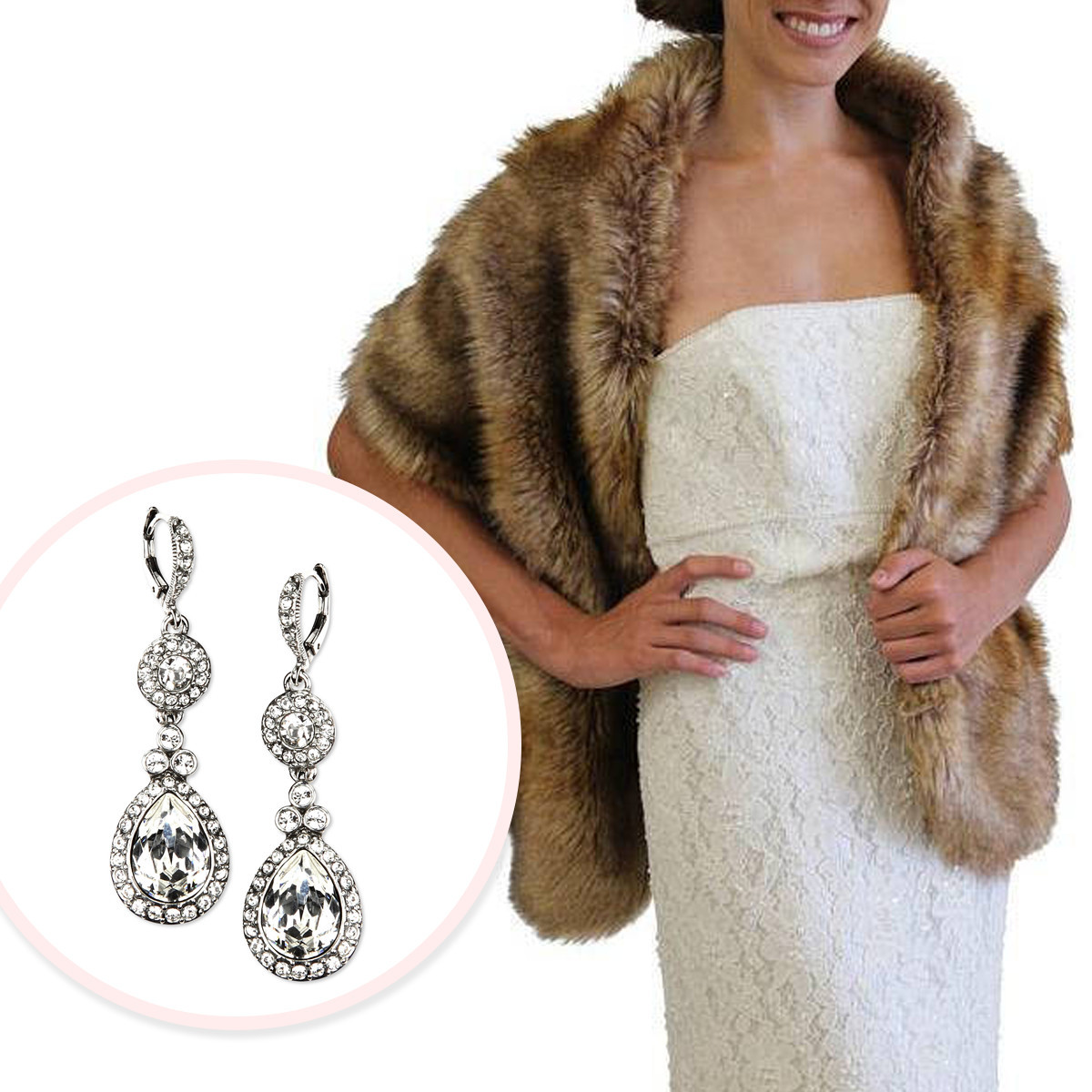 Bride in bridal dress with a faux fur wrap next to diamond dangling earrings photo