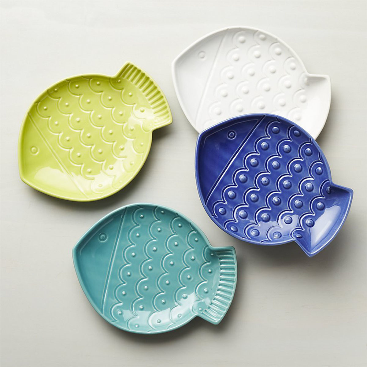 Crate and Barrel set of four fish plates in blue, aqua, white, and lime photo