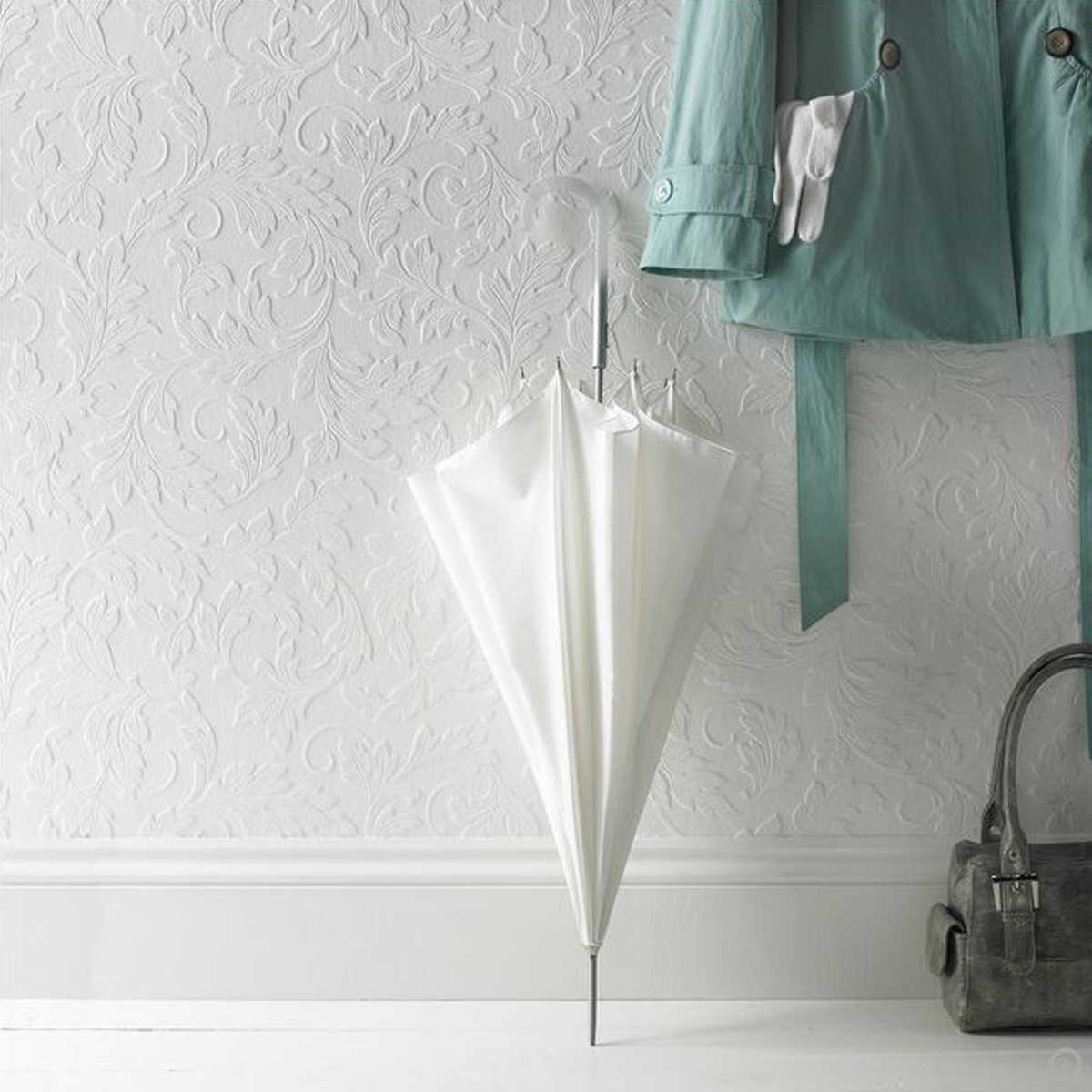 White wallpaper with traditional scrolling leaf design photo