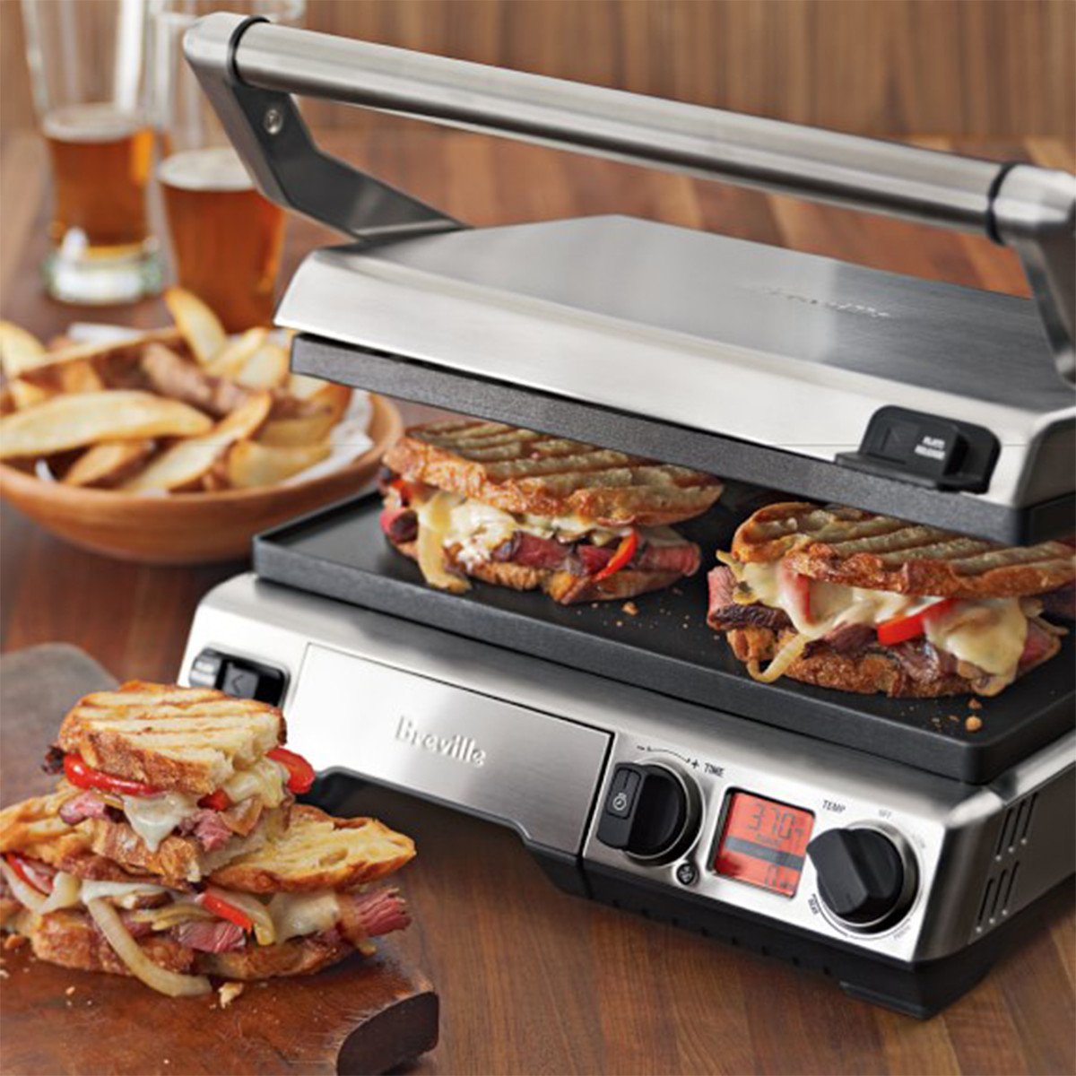 Small smart grill making panini sandwiches photo