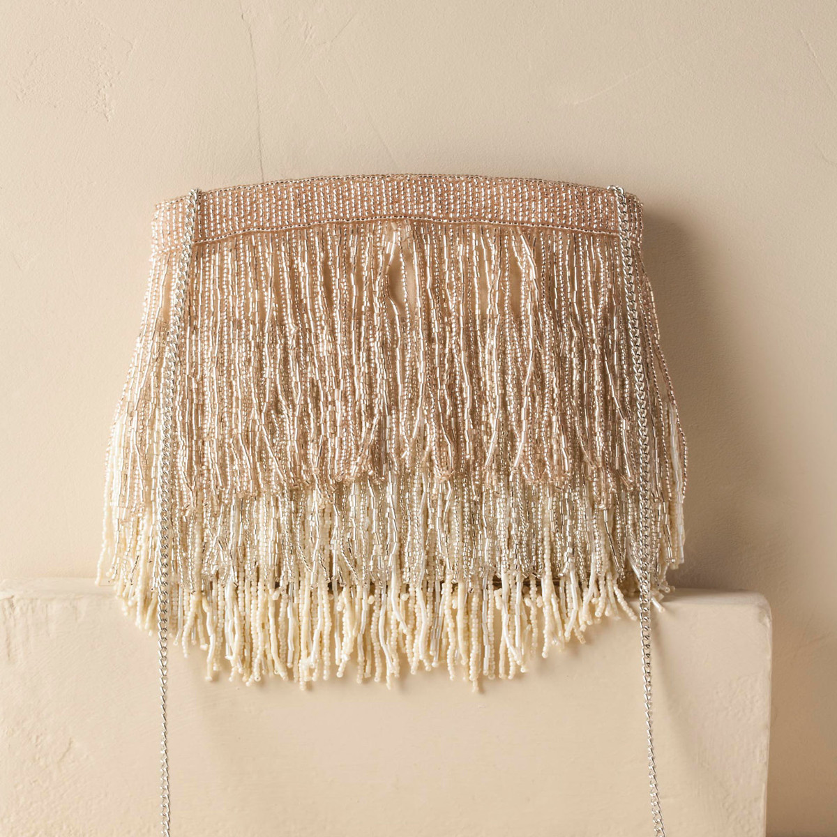 Ivory bohemian clutch with extensive fringe and a strap photo