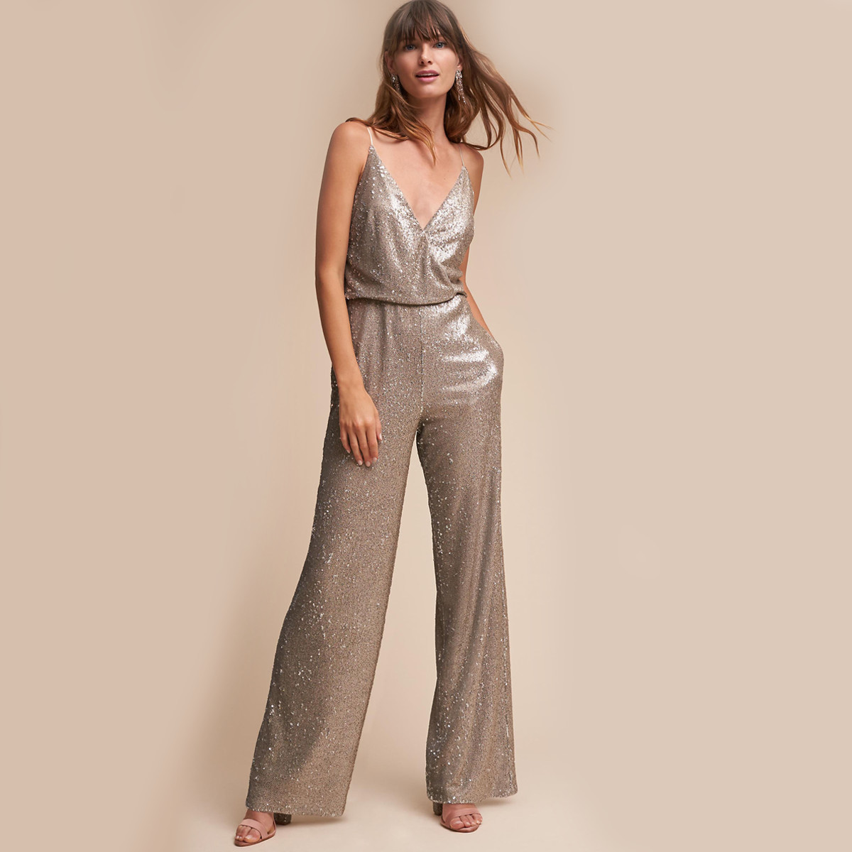 Woman wearing a gold jumpsuit photo