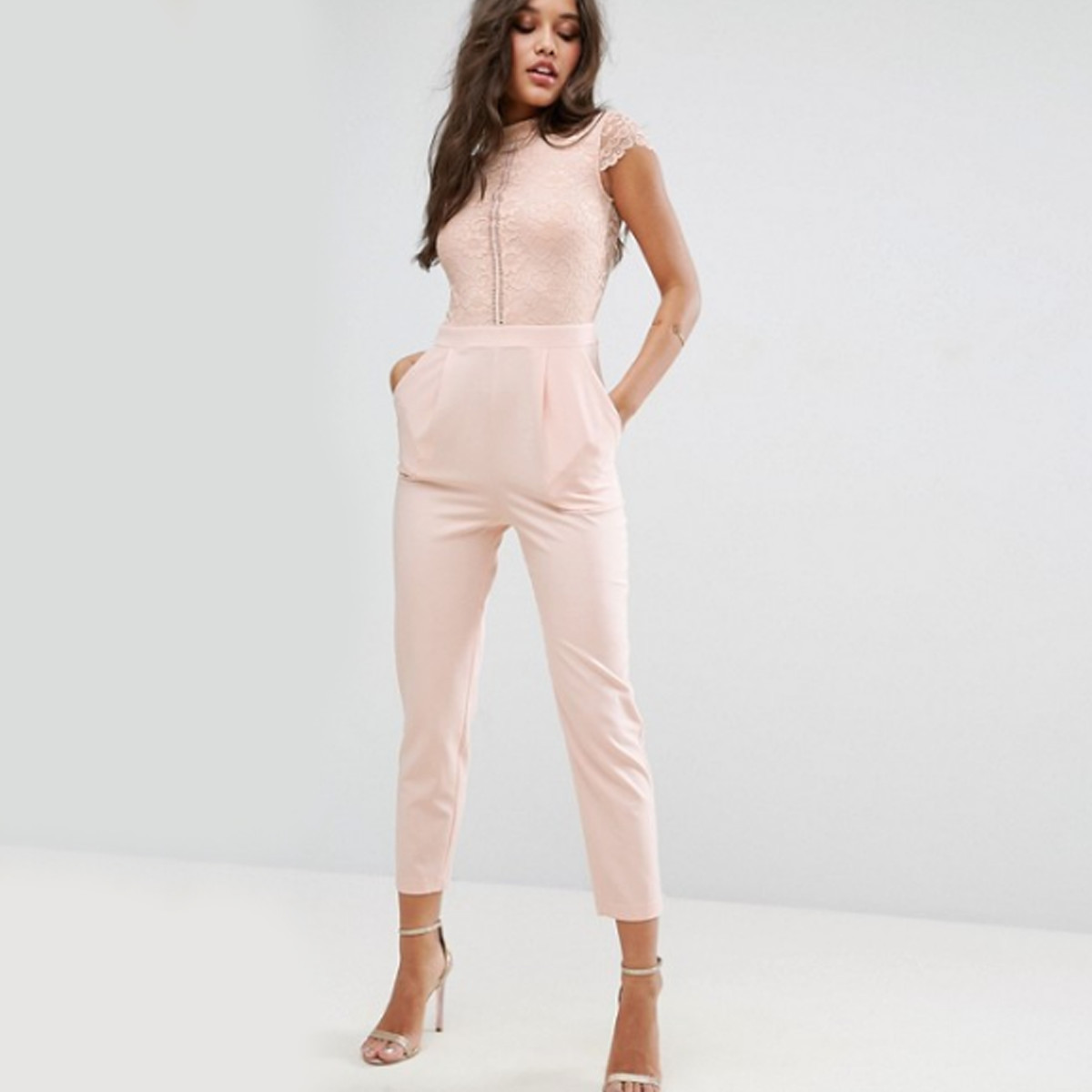 Woman in a lace jumpsuit photo