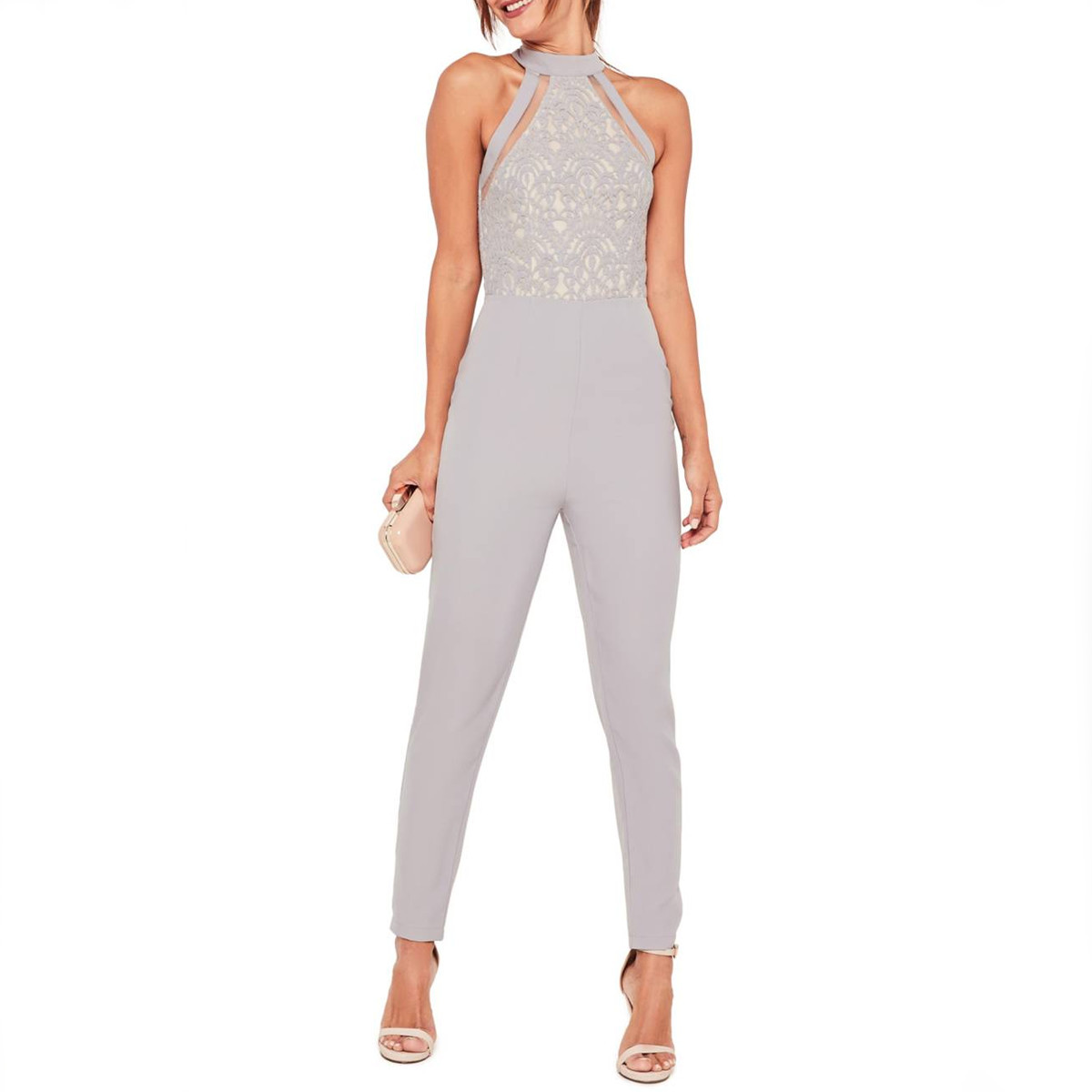 Woman in a silver sleeveless jumpsuit photo