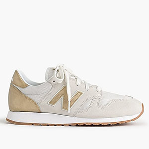 Gold New Balance sneakers photo