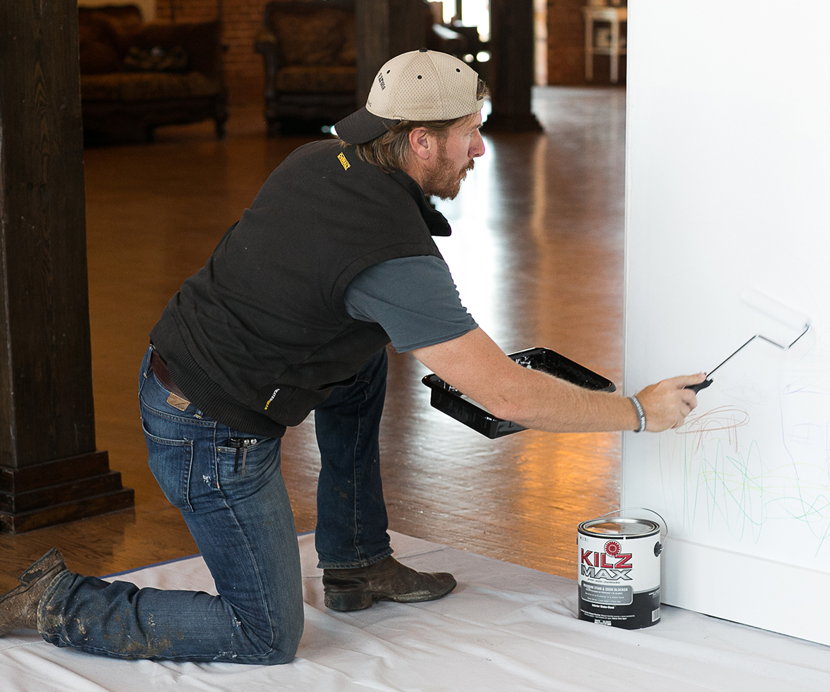 Chip Gaines painting over walls with scribbles on it photo