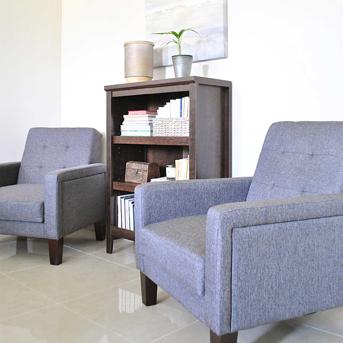 Comfy sitting area on one side with Porter Chairs, and a 3-Shelf Bookcase which ties the room together. photo