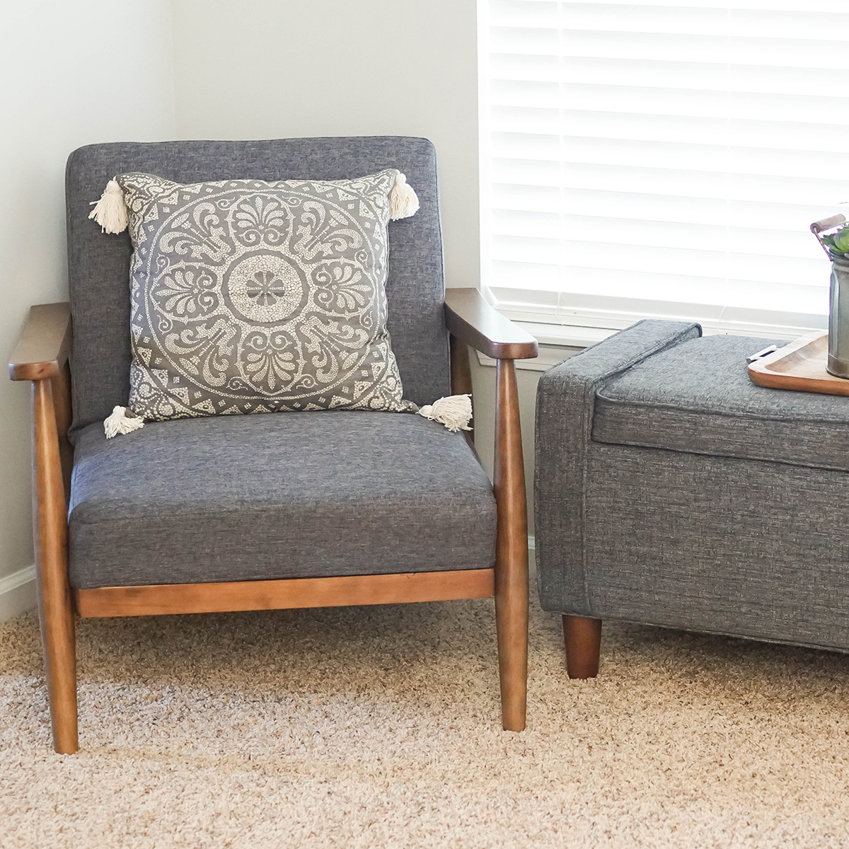 Matching Flynn Mid-Century Chairs and Taupe Medallion Decorative Pillows provide style while a Flynn Mid Century Modern Upholstered Storage Bench adds some extra hideaway space. photo