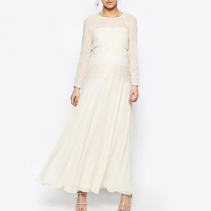 woman in maternity off-white dress from Asos photo