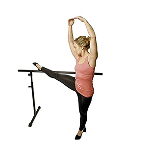 Woman balancing on a free-standing barre photo