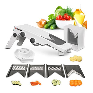 White and gray mandoline slicer with five blade options photo