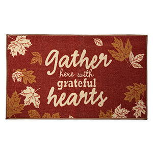 Welcome your guests with this durable fall-inspired rug. photo