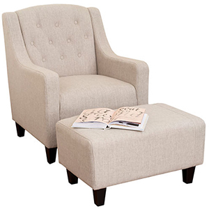 Homey, tufted armchair and ottoman set is the perfect place to curl up with a good book. photo