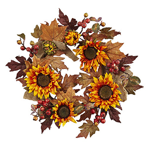 Fall wreath featuring bright sunflowers and vibrant red berries will create a warm welcome to your front door. photo