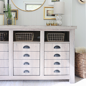 Cottage-style entryway featuring modern farmhouse cabinet with faux wood table lamp. photo