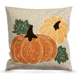 Burlap throw pillow with large orange pumpkin and small yellow pumpkin on it photo