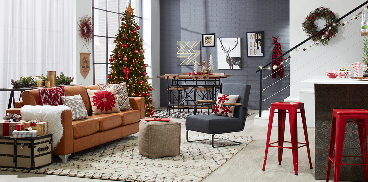 Room decorated for holidays with Christmas tree, wreath, and pillows photo