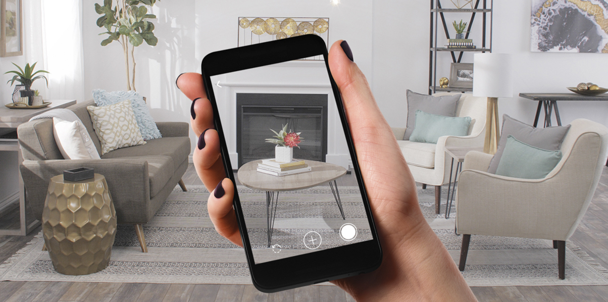 Person using Overstock's mobile app photo