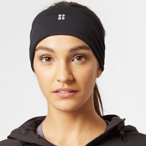 Large black headband with the Sweaty Betty logo on the front. photo