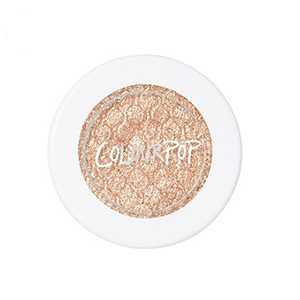 White container of shimmery champagne Colourpop eyeshadow photo