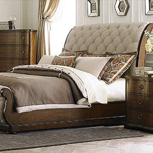 Tufted upholstered bed from Overstock photo
