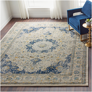 Blue and white area rug with distressed pattern photo