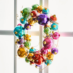 A vibrant wreath of ornament globes of different sizes and colors. photo