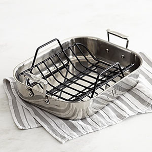 Stainless-steel roaster with wire rack. photo