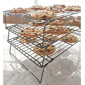 Three-tier cooling rack for baked goods. photo