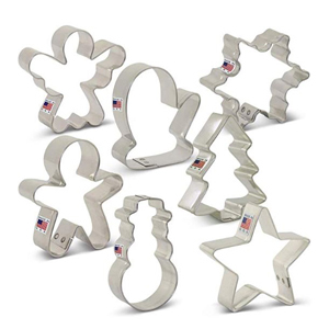 Cookie cutters in snowman and gingerbread man shapes. photo
