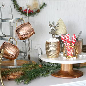 Better Homes & Gardens cake stand, mug rack, and gold candles photo