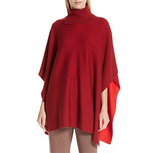 Red knit poncho with turtleneck photo