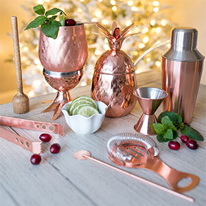 Copper bar set including a glass, shaker, and utensils photo