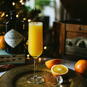 A mimosa on a platter with oranges photo