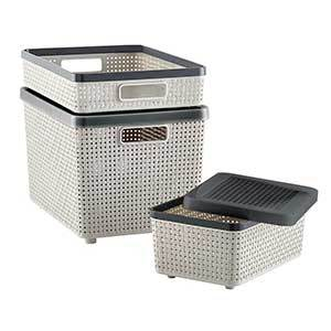Three woven storage containers in small, medium, and large. photo